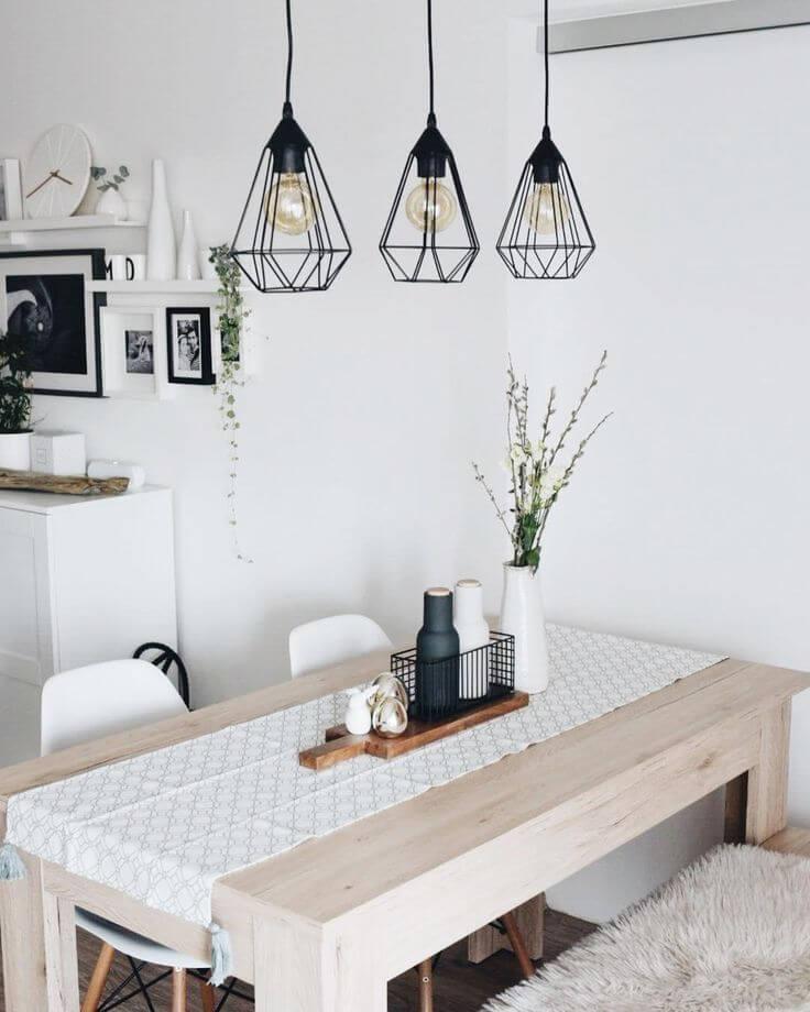 Iluminación sobre mesa de comedor